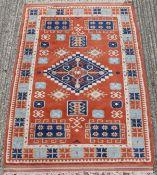 An orange ground wool rug. 190 x 120.