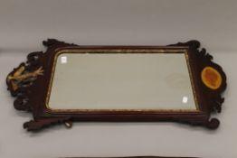 An 18th century style mahogany wall glass. 91 cm high.