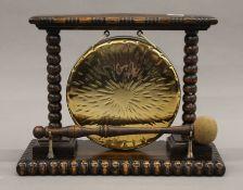 An early 20th century oak framed table gong.