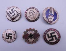 Six enamel Nazi style badges.
