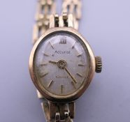 A 9 ct gold ladies Accurist wristwatch. 10.9 grammes total weight.