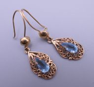 A pair of gold and blue stone earrings. 3.9 grammes total weight.