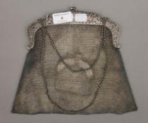 An 800 silver mesh handbag with a mesh purse. 19 cm wide. 14.6 troy ounces.
