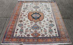 A large cream ground wool rug. 330 x 260 cm.