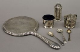 A cased silver cruet set with two plated spoons and a silver hand mirror. The latter 27 cm high. 3.