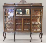 An Edwardian mahogany display cabinet. 171.