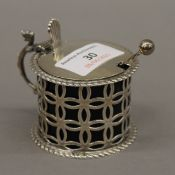 A silver mustard pot with a silver spoon. 6 cm high. 2.6 troy ounces.