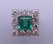 An 18 ct gold and platinum emerald and diamond ring. Ring size H/I (with previous sizing mounts). 1.