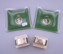 Two boxed silver napkin rings engraved for The Women's Royal Army Corps and two ashtrays.