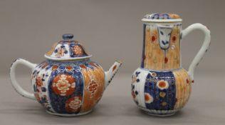 An 18th century Imari tea pot and a hot water jug. The former 11 cm high.