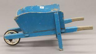 A vintage child's wheelbarrow. 70 cm long.
