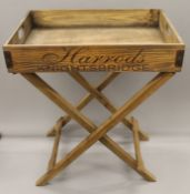 A wooden tray on stand. 65 cm long.