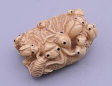 A Chinese bone carving of insects. 4.5 cm long.