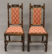 A pair of early 20th century oak chairs. 45 cm wide.