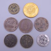 Eight Chinese coins.