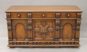 A 20th century carved oak sideboard. 157 cm wide.