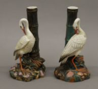 A pair of Royal Worcester porcelain bud vases, each decorated with a swan. 20 cm high.