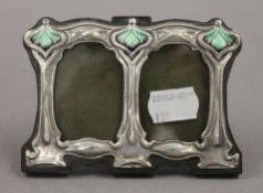 A silver Art Nouveau style double photograph frame. 11 cm wide.