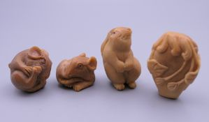 Four carved bone netsuke. The largest 4 cm high.