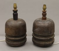 A pair of wooden lamps formed from carriage wheel hubs. Each 40 cm high.
