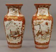 A pair of 19th century Japanese Kutani porcelain vases. Each 33 cm high.
