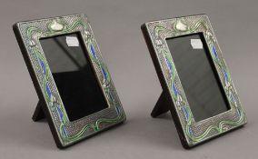 A pair of Art Nouveau style silver photograph frames. 14.5 x 19 cm.