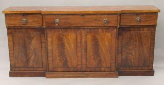 A 19th century mahogany break front sideboard. 207 cm long. 42.5 cm deep, 95 cm high.