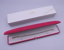 A 9 ct gold, sapphire and diamond bracelet. 18 cm long. 10.5 grammes total weight.