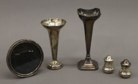 A quantity of silver items, including bud vases. 5.4 troy ounces, vases loaded.
