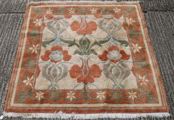 A large wool rug retailed by Liberty. 210 x 195 cm.