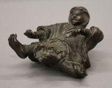A Japanese bronze figure of a warrior. 10 cm high.