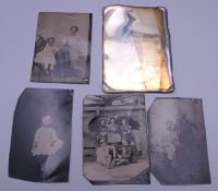 Five early tin type photographs. The largest 7.5 x 10.5 cm.