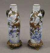 A pair of Royal Worcester Shibyama style decorated porcelain vases. 24 cm high.