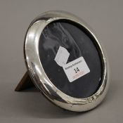 An oval silver photograph framed, hallmarked Birmingham 1922. 12.5 cm diameter.