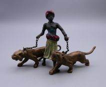 A cold painted bronze model of an Arab and tigers. 7 cm high.
