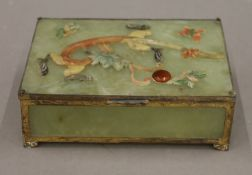 A small Chinese jade trinket box decorated with a dragon. 14 cm wide.