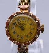 A 9 ct gold cased Rotary ladies wristwatch. 2 cm wide. 15.7 grammes total weight.