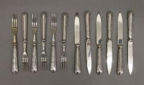 A set of twelve 925 silver handled dessert knives and forks.