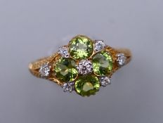 A 9 ct gold Victorian style diamond and peridot ring, engraved design to the sides. Ring size M/N.