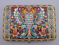 An enamel decorated silver cigarette case bearing Russian marks. 12.5 cm wide.