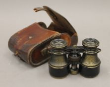 A pair of vintage binoculars, set with a compass, inscribed ''The 'Links' Lawrence & Mayo'',