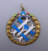 An enamelled decorated silver gilt medallion bearing Russian marks. 4.5 cm diameter.