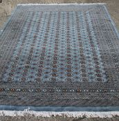 A large blue ground rug and a small red ground rug. 378 x 287 cm and 147 x 89 cm respectively.