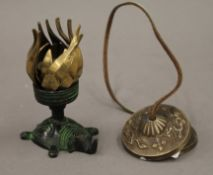 A bronze lotus flower and Tibetan cymbal. The former 11 cm high.