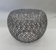 A contemporary circular link metal coffee table.