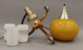 A mid-20th century orange glass pendant light shade,