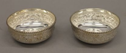 A boxed pair of Indian silver bowls. Each 8.5 cm diameter.