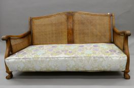 An early 20th century three piece bergere suite. The settee 156 cm wide.
