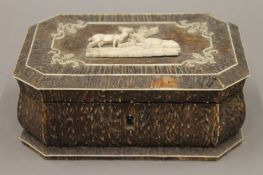 A 19th century stag antler and ivory box. 17 cm wide.
