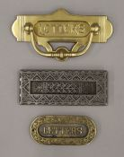 A Victorian cast iron letter box by Kenrick & Sons and two brass letter boxes.